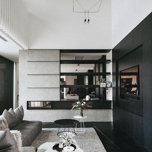 アデレードのコンテンポラリースタイルのおしゃれなリビング (白い壁、濃色無垢フローリング、両方向型暖炉、壁掛け型テレビ、黒い床) の写真