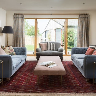 Photo of a medium sized farmhouse formal enclosed living room in Dorset with white walls.