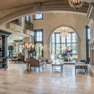 Example of a huge classic formal and open concept porcelain floor living room design in St Louis with beige walls, a standard fireplace, a stone fireplace and no tv