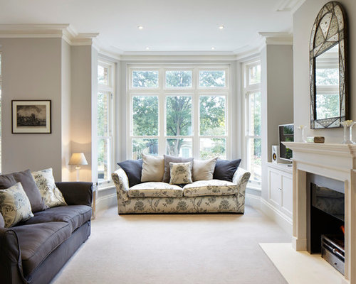 Example Of An Ornate Carpeted Living Room Design In London With A Standard  Fireplace And Gray