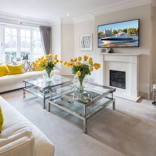 Inspiration for a medium sized classic enclosed living room in Berkshire with brown walls, carpet, a standard fireplace, a stone fireplace surround, a wall mounted tv and grey floors.