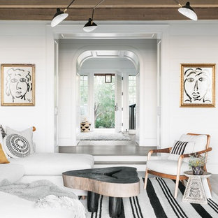 Inspiration for a beach style enclosed dark wood floor living room remodel in Charleston with white walls and no fireplace