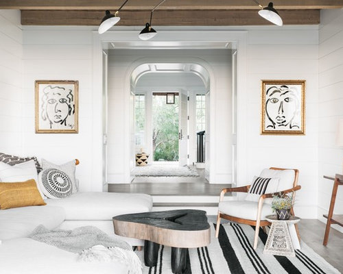 Inspiration For A Beach Style Enclosed Dark Wood Floor Living Room Remodel  In Charleston With White