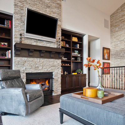 Inspiration for a mid-sized transitional loft-style dark wood floor and brown floor living room remodel in Seattle with a stone fireplace, white walls, a standard fireplace and a wall-mounted tv