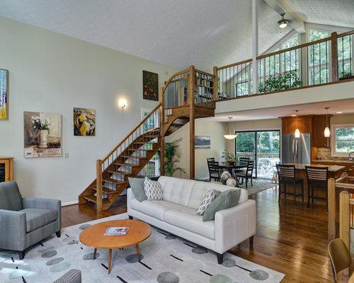 Example Of An Eclectic Open Concept Dark Wood Floor Living Room Design In Atlanta