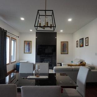 Foto de salón abierto, minimalista, con paredes blancas, suelo de madera en tonos medios, chimenea tradicional, marco de chimenea de baldosas y/o azulejos, televisor colgado en la pared y suelo rojo