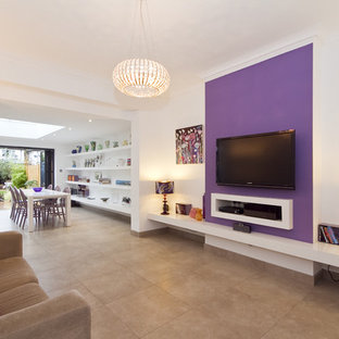 This is an example of a contemporary open plan living room in London with purple walls.