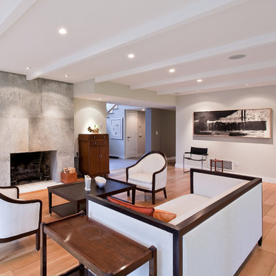 Living room - large contemporary formal and open concept light wood floor and brown floor living room idea in Vancouver with a standard fireplace, a concrete fireplace, beige walls and no tv