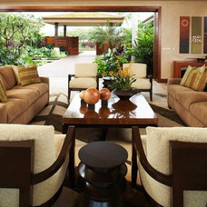 Tropical Living Room by Knudson Interiors