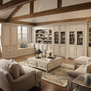 Large elegant open concept medium tone wood floor living room library photo in Detroit with white walls, no fireplace and a concealed tv