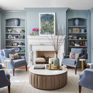 デンバーの中くらいのトラディショナルスタイルのおしゃれなLDK (フォーマル、青い壁、無垢フローリング、標準型暖炉、石材の暖炉まわり、テレビなし、茶色い床) の写真