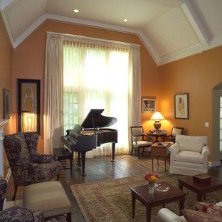 Foto de salón para visitas cerrado, clásico, de tamaño medio, sin televisor, con parades naranjas, suelo de madera oscura, chimenea tradicional, marco de chimenea de yeso y suelo marrón