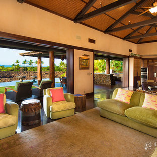 Large tropical open concept living room in Hawaii with beige walls.