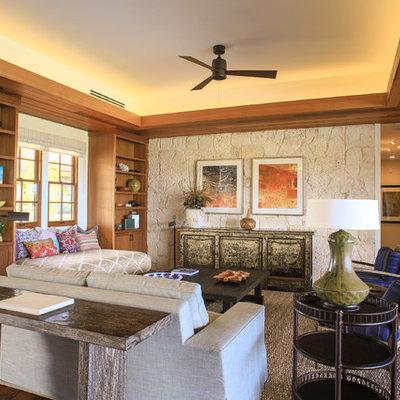 Living room - tropical open concept dark wood floor living room idea in Hawaii with beige walls