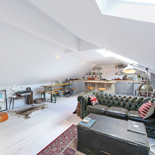 Example of a small eclectic formal and open concept painted wood floor living room design in London with white walls and no fireplace