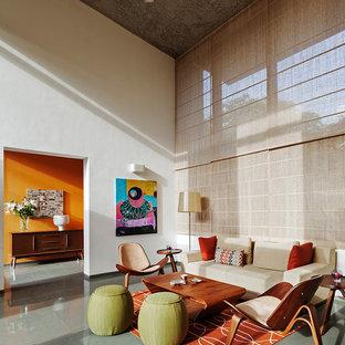 バンガロールの中くらいのミッドセンチュリースタイルのおしゃれなLDK (白い壁、磁器タイルの床、暖炉なし、テレビなし、グレーの床) の写真