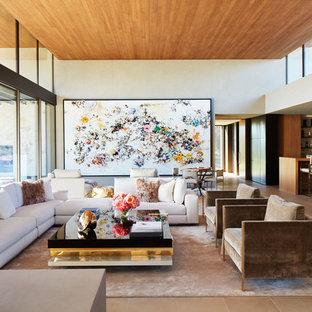 Immagine di un grande soggiorno minimalista aperto con angolo bar, pavimento in pietra calcarea, pavimento beige, pareti bianche, nessun camino e nessuna TV