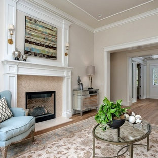 Elegant formal light wood floor living room photo in San Francisco with beige walls, a standard fireplace and no tv