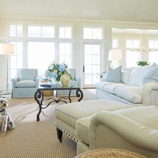 ウィルミントンの大きいビーチスタイルのおしゃれなLDK (白い壁、カーペット敷き、標準型暖炉、石材の暖炉まわり、埋込式メディアウォール、ベージュの床) の写真