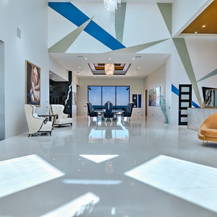 Large trendy loft-style porcelain tile living room photo in Orange County with a music area, white walls, no fireplace and no tv