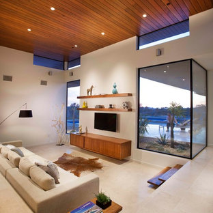 Photo of a contemporary formal living room in San Diego with white walls, no fireplace and a wall mounted tv.