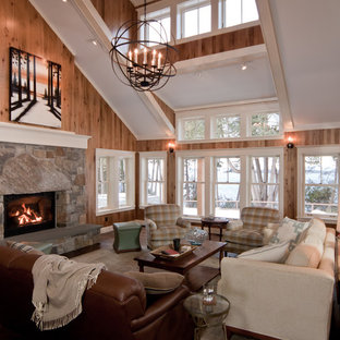 Photo of a large traditional open plan living room in Burlington with a standard fireplace, a stone fireplace surround, brown walls and dark hardwood flooring.