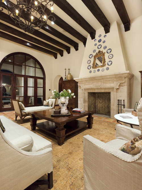 Example Of A Large Tuscan Living Room Design In Austin With Beige Walls And Standard