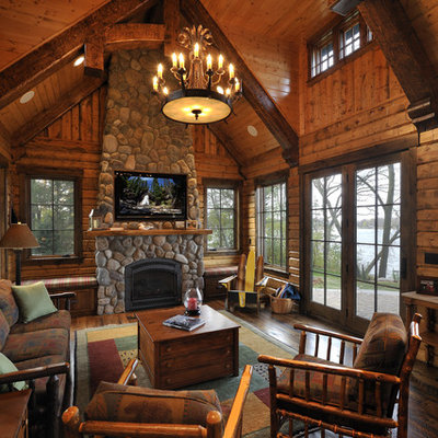 Inspiration for a large rustic living room remodel in Minneapolis with a standard fireplace and a stone fireplace