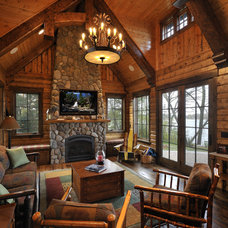 Rustic Living Room by Lake Country Builders