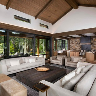 Inspiration for a rustic medium tone wood floor and brown floor living room remodel in Denver with white walls