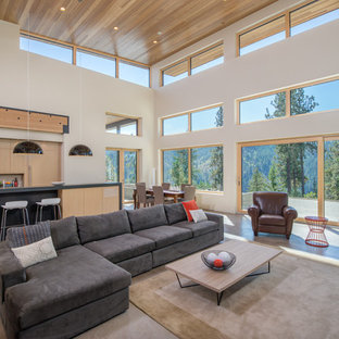 Inspiration for a large contemporary open concept concrete floor living room remodel in Seattle with white walls