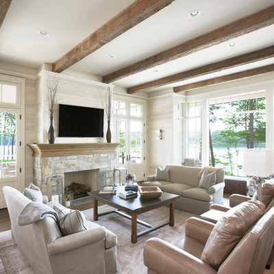 Inspiration for a timeless formal and open concept medium tone wood floor living room remodel in Other with beige walls, a standard fireplace, a stone fireplace and a wall-mounted tv