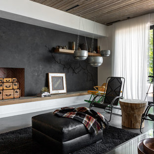 Inspiration for a beach style gray floor living room remodel in Milwaukee with a standard fireplace and black walls