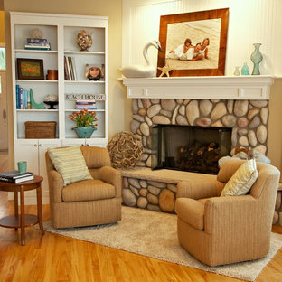 Inspiration for a beach style medium tone wood floor living room remodel in Detroit with a corner fireplace and a stone fireplace