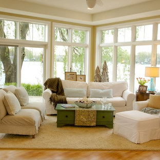 Inspiration for a mid-sized coastal open concept medium tone wood floor and beige floor living room remodel in Detroit with beige walls and no tv