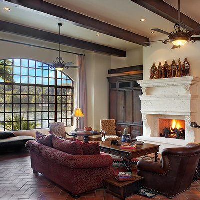 Huge mountain style living room photo in Austin with a standard fireplace