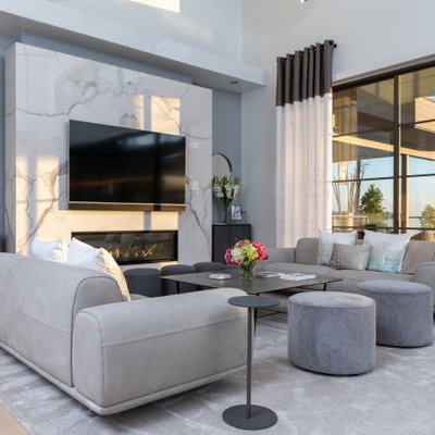 Living room - contemporary open concept light wood floor and beige floor living room idea in Dallas with white walls, a ribbon fireplace, a stone fireplace and a wall-mounted tv