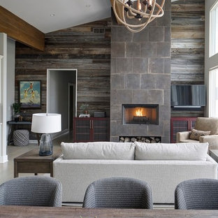 Example of a trendy open concept beige floor living room design in Chicago with gray walls, a standard fireplace, a tile fireplace and a wall-mounted tv