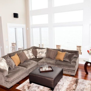 Inspiration for a large contemporary open concept medium tone wood floor living room remodel in New York with beige walls and a wall-mounted tv