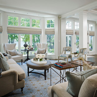 Example of a large classic formal and open concept dark wood floor living room design in Chicago with white walls, no fireplace and no tv