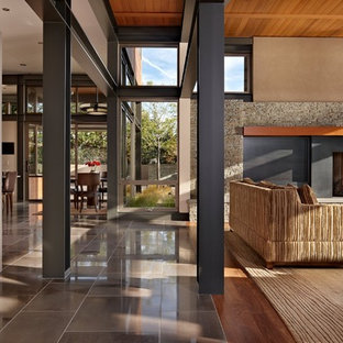 Living room - modern living room idea in Seattle with a standard fireplace and no tv