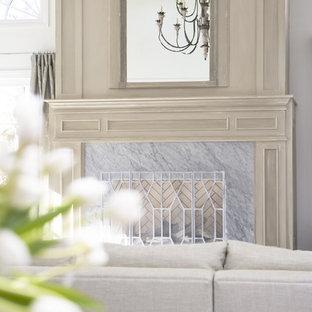 他の地域の大きいコンテンポラリースタイルのおしゃれな独立型リビング (白い壁、標準型暖炉、石材の暖炉まわり、テレビなし、フォーマル) の写真