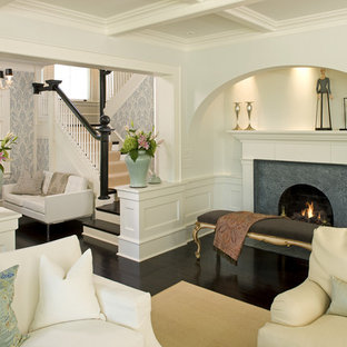 Inspiration for a traditional living room in Minneapolis with white walls and a standard fireplace.