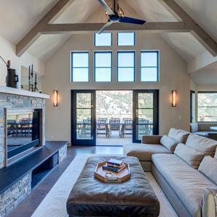 サンフランシスコの広いコンテンポラリースタイルのおしゃれなLDK (白い壁、標準型暖炉、積石の暖炉まわり、三角天井) の写真