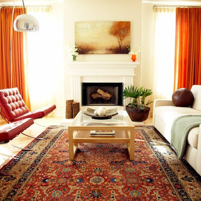 Example of a trendy living room design in Los Angeles with beige walls, a standard fireplace and no tv
