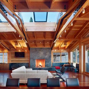 Idée de décoration pour un salon design avec un manteau de cheminée en pierre.