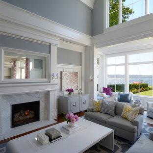 Esempio di un grande soggiorno chic aperto con pareti blu, parquet scuro, camino classico, sala formale, cornice del camino in pietra, nessuna TV e pavimento marrone