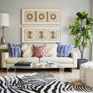 Mid-sized eclectic enclosed medium tone wood floor and beige floor living room photo in Dallas with gray walls