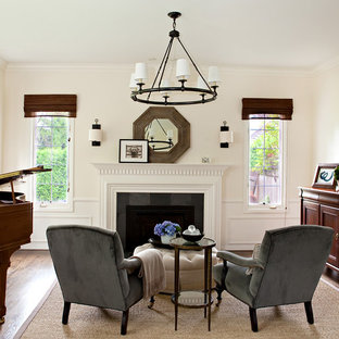 Example of a classic dark wood floor living room design in Seattle with a music area, white walls and a standard fireplace