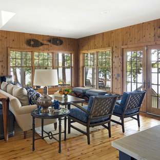 Example of a beach style formal medium tone wood floor living room design in Minneapolis with brown walls, no fireplace and no tv